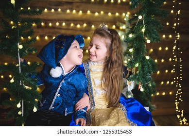 festive laughing children looking one on another on seesaw