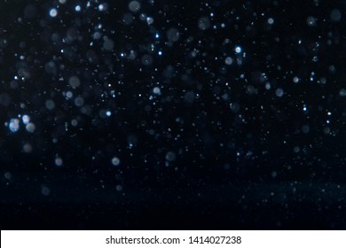 Festive light background with bokeh and stars, Christmas and New Year holiday background