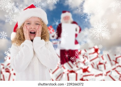 Festive little girl with hands on face against blue sky with white clouds