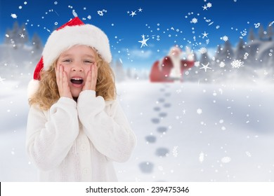 Festive little girl with hands on face against bright blue sky over clouds