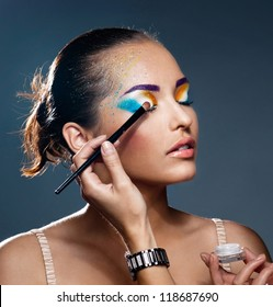 Festive makeup on beautiful face of girl