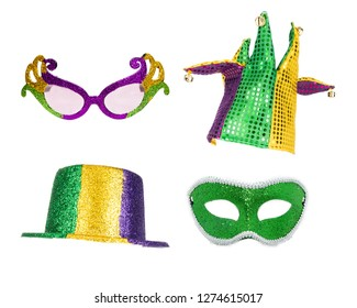 Festive Mardi Gras party hats, glasses and mask isolated on white for compositing