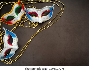 Festive mardi gras venetian or carnivale mask on a dark background, Empty space for design