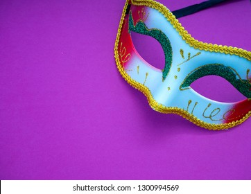 Festive mardi gras venetian or carnivale mask on a purple background, Empty space for design