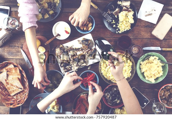 Festive meal. Christmas or Thanksgiving. Happy family at dinner. A Variety of Home-made Dishes
