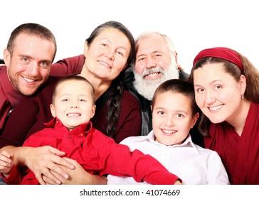 Festive multigenerational family portrait isolated on white