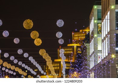 Festive night illumination, balloons and lights against the backdrop of beautiful modern buildings with lighting in the Ukrainian city of Dnipro, Dnepropetrovsk, Ukraine. (Dnipro, Dnipropetrovsk).