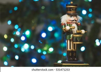 Festive nutcracker soldier with bokeh blurred fairy light