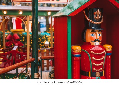 Festive nutcracker soldier toys at the Christmas market in Germany. Evening time. Celebrating new years holidays.