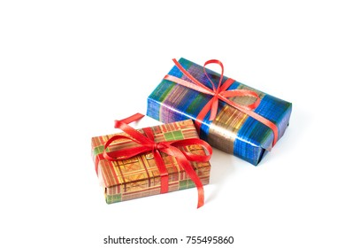 Festive packaging mock up. Two gifts boxes wrapped in decorative colorful paper and tied with red ribbons