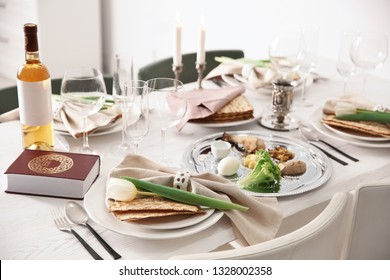 Festive Passover table setting with Torah. Pesach celebration