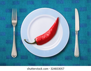 Festive pepper on white plate with knife and fork