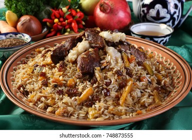 Festive pilaf.Mutton,rice,carrots,vegetable oil,raisins,chickpeas,onion,turmeric,black pepper,cumin.Pilaf ready to put on lagans and serve with tea and salad.Uzbek national dish.