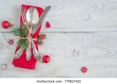 festive place setting for christmas dinner on white rustic background with copy space