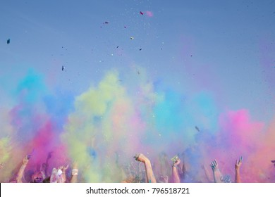 festive powder colours hands in the air during daytime