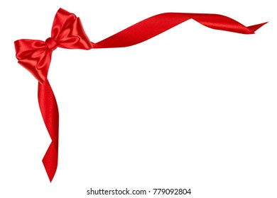 Festive red bow made of ribbon isolated on white background