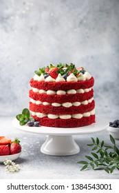 festive  Red Velvet cake on white cake stand,  selective focus,