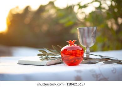 Festive Rosh HaShanah table Jewish New Year Concept Pomegranate Siddur Prayer Book