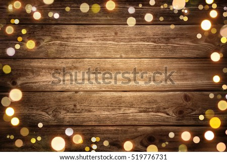 85d4816cadec6 Festive rustic wood background with dark vignette and framed by glowing  bokeh lights