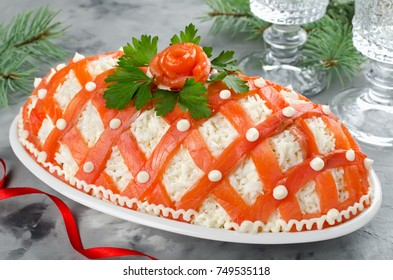 Festive salad, decorated with salmon. The idea for a delicious and merry holidays