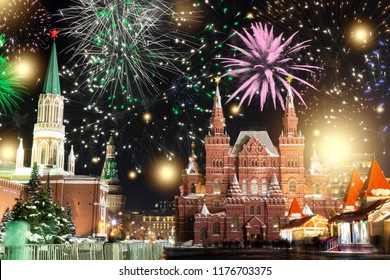 Festive salute and fireworks on the red square in Moscow. Salute lights over the Kremlin and GUM at the New Year celebration. Multicolored salute for Christmas in Moscow at night, Russia
