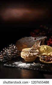 Festive, seasonal, Christmas mince pies shot against a festive, Thanksgiving and Christmas background with generous accommodation for copy space.