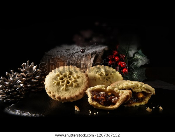 Festive, seasonal, Christmas mince pies shot against a festive, Thanksgiving and Christmas background with generous accommodaton for copy space.