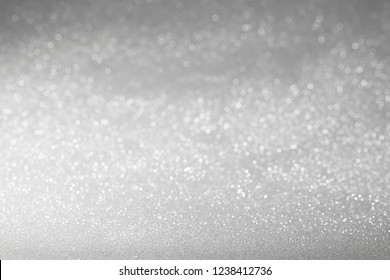 Festive silver glitter background. New Year and Christmas background