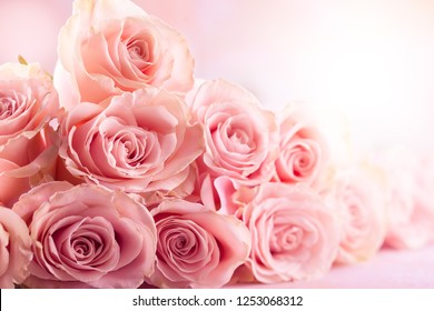 Festive still life with pink roses. Flower composition with roses. Soft focus.