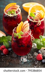 Festive summer berry and fruit sangria with apple and oranges