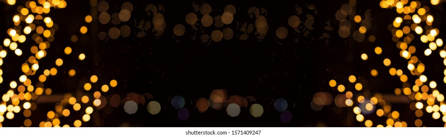 festive symmetry pattern holiday golden illumination bokeh and sparkles frame on black background empty copy space for your text here
