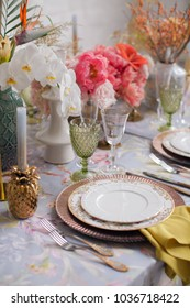 Festive table decor. Many pastel colors. Luxury wedding, party, birthday. Yellow berries. Copper chairs and dishes, gold and silver cutlery.  Chinese, European, chinoiserie style. Peonies and roses.
