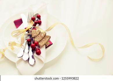 Festive table setting among winter decorations