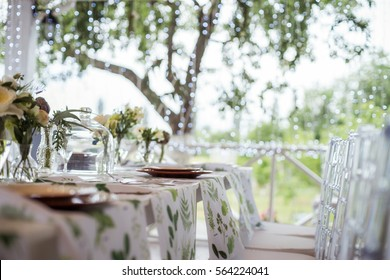 Festive table setting, catering. Wedding in rustic style in summer, outdoor.