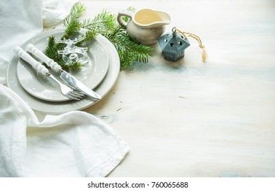 Festive table setting for Christmas dinner on rustic wooden table with copyspace