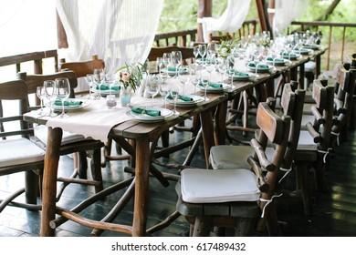 festive table setting in classic style, setout.. Wedding table decor. Table layout. Restaurant interior. Fine art. expectation of guests.