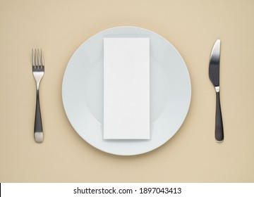 Festive table setting with cutlery, white dinner plate on beige table background. Blank card mockup, restaurant menu concept with empty menu card on a plate, top view, flat lay