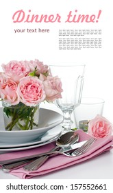 Festive table setting with pink roses, candles and shiny new cutlery on a white background, isolated, ready template