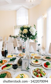 Festive table setting in restaurant with numeration