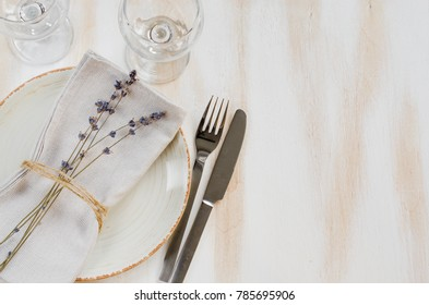Festive table setting at vintage or provence style with lavender. Concept Birthday, Valentine's, Mother's or Father's Day. Closeup. Copy space, top view.
