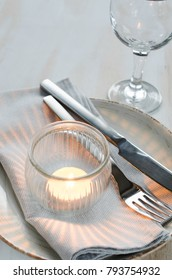 Festive table setting at vintage or provence style with candle and lavender. Concept Birthday, Valentine's, Mother's or Father's Day. Closeup.