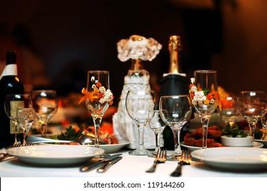Festive table setting wedding table, beautiful glasses wine and food
