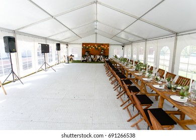 Festive table setting in a white tent