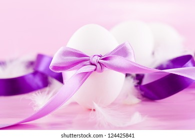 festive traditional easter egg decoration purple satin ribbon on pink
