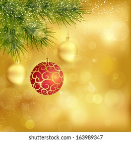 Festive traditional golden Christmas background with hanging baubles, blurry lights and fir twigs for the magical season to come.