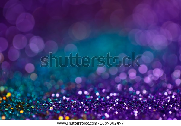 Festive twinkle lights background, abstract sparkle backdrop with circles,modern design wallpaper with sparkling glimmers. Blue, purple and green backdrop glittering sparks with glow effect