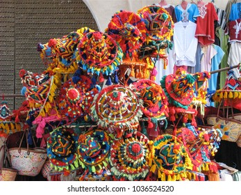 Festive Watermen Hats, worn by Berber Hawkers of Water in the cities of Morocco, for sale in Marrakesh