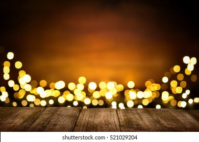 Festive wooden background with glittering bokeh lights, illuminated by a spotlight, ideal for Christmas or other occasions