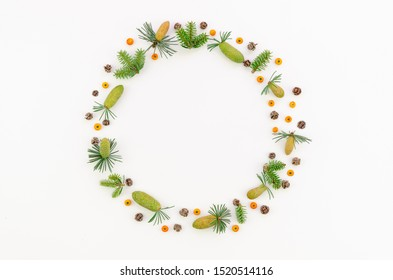 Festive wreath of grape vines with fur branches, rowanberries and cones. Christmas DIY frame. New Year round wreath on white background. Flat lay mockup