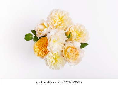 Festive yellow white flower English rose composition on the white background. Overhead top view, flat lay. Copy space. Birthday, Mother's, Valentines, Women's, Wedding Day concept.